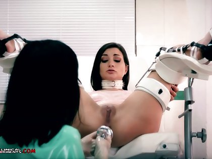 Crazy nurse, Minerva is toying with Valentina Bianco, while they are alone in a catch office