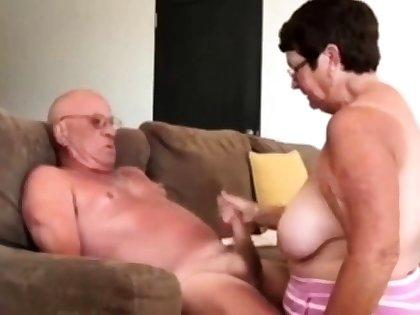 Girl giving husband a blow hand job