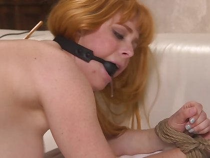Cougar is gagged and gets banged yon the doggy style position