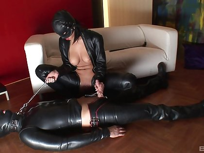 Dominant woman helter-skelter latex costume, intriguing femdom