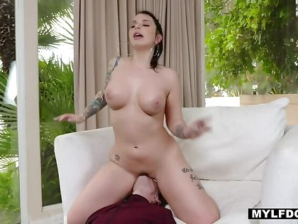 Inked FemDom Ivy Lebelle sits on Lucky House-servant