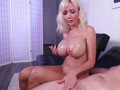 Oiled-up blonde Victoria Lobov gives a great handjob